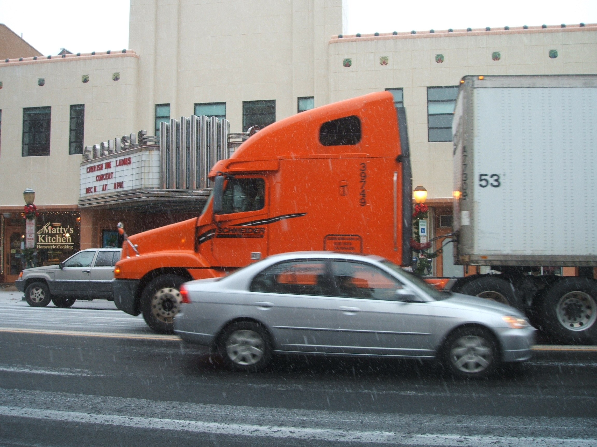 Truck and Car Passing Carlisle Theater, December 5th, 2007. Photograph by Ellen Simon.